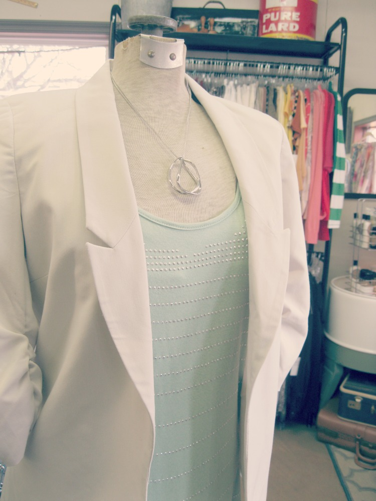 mint pastel top with a neutral jacket
